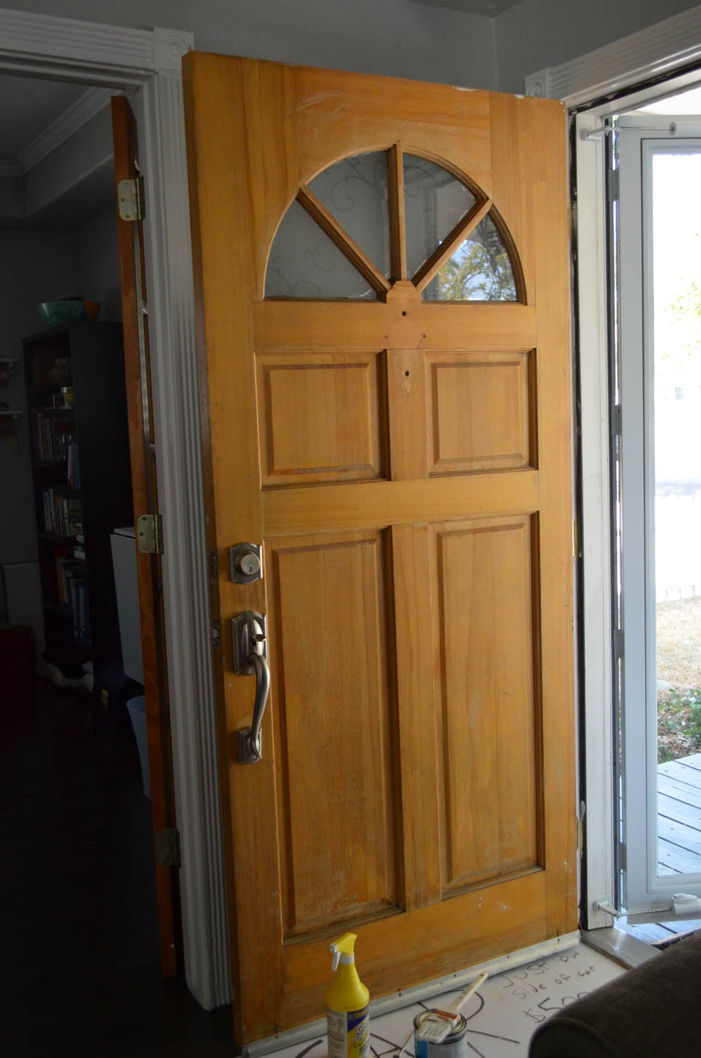 Wood front door of home before painting pink