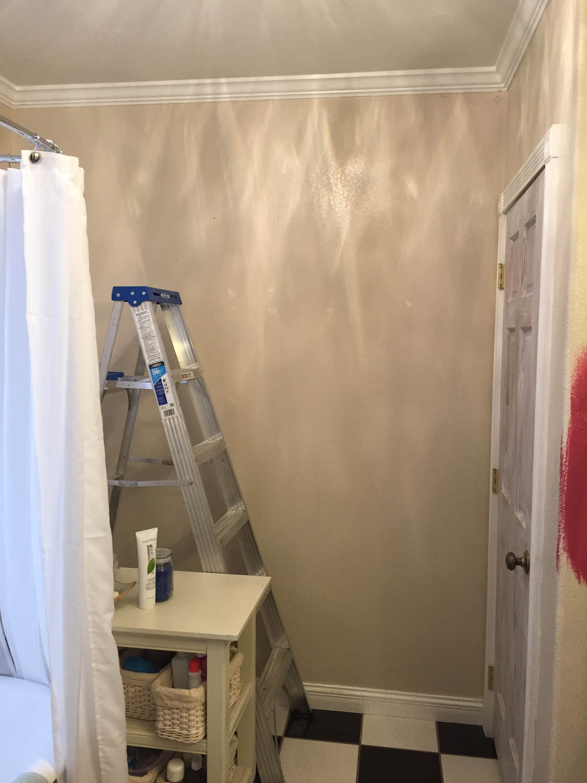 Master bathroom before hanging pink wallpaper
