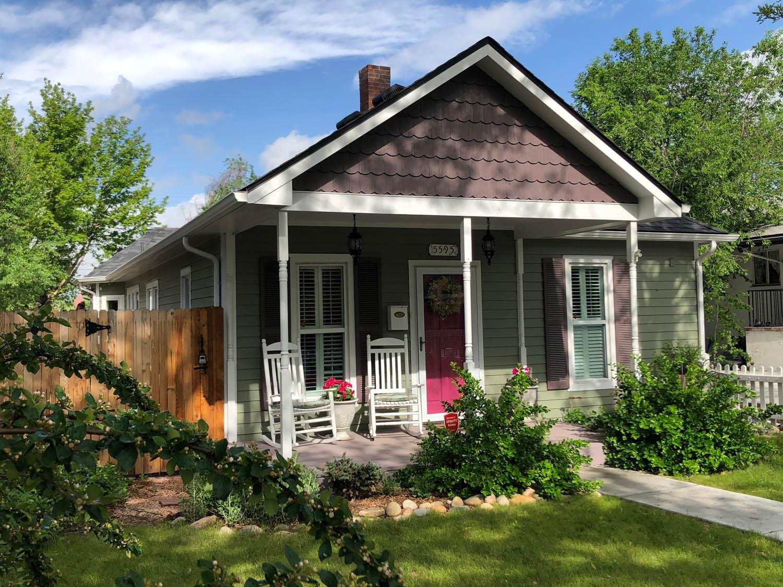 Curtice Cottage exterior elevation in spring after remodel