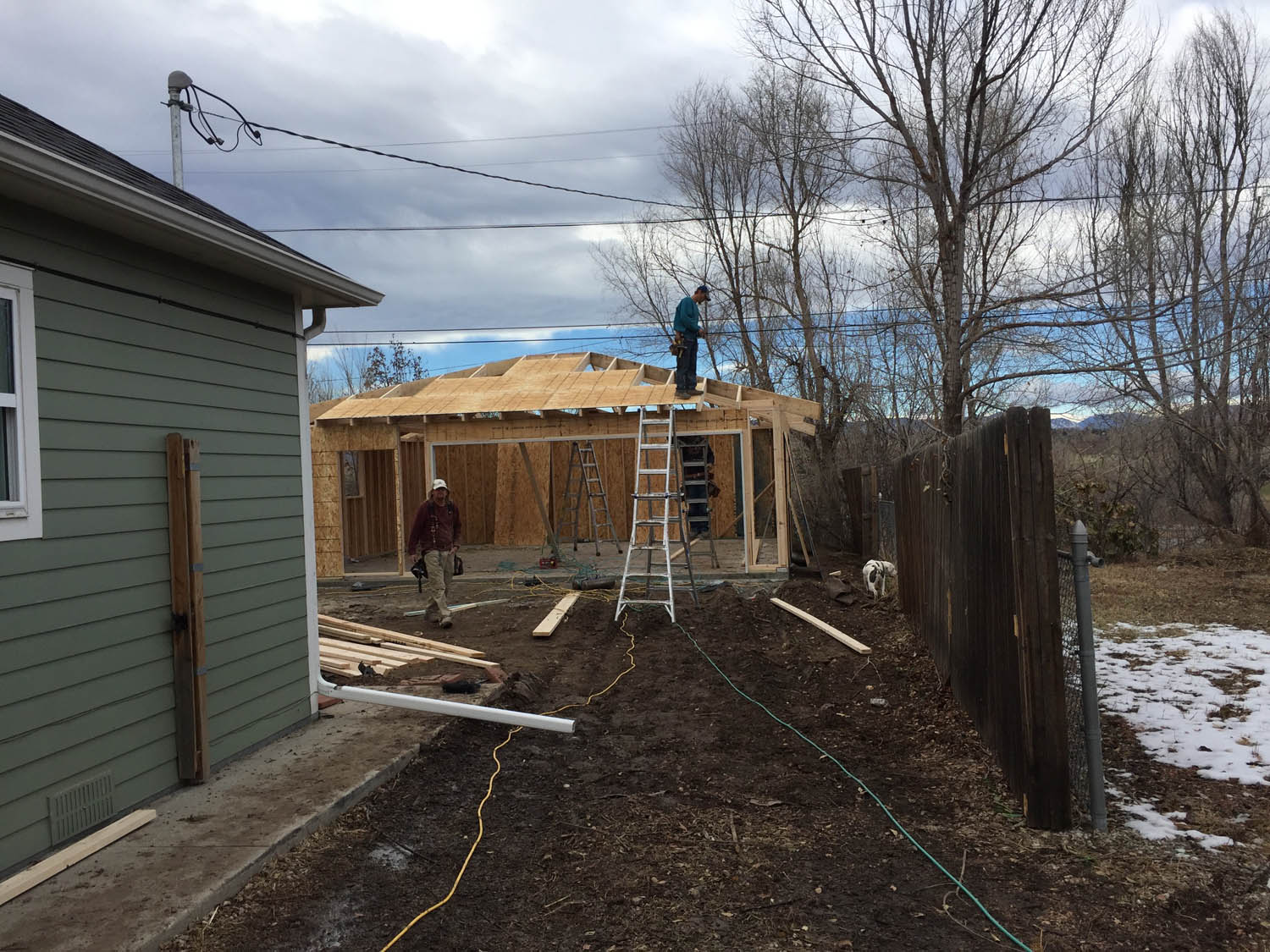 Building a garage in back of Curtice Cottage in historic Littleton, Colorado