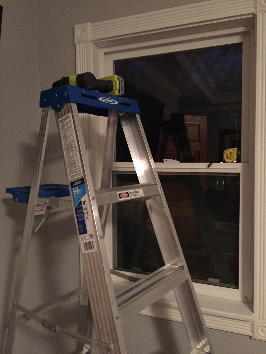 Always working late into the night hanging blinds