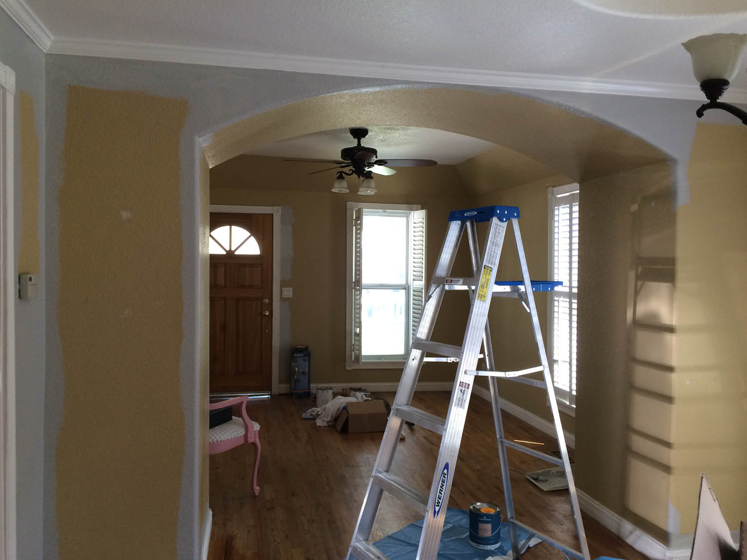 View into living room before renovation with ladder in front