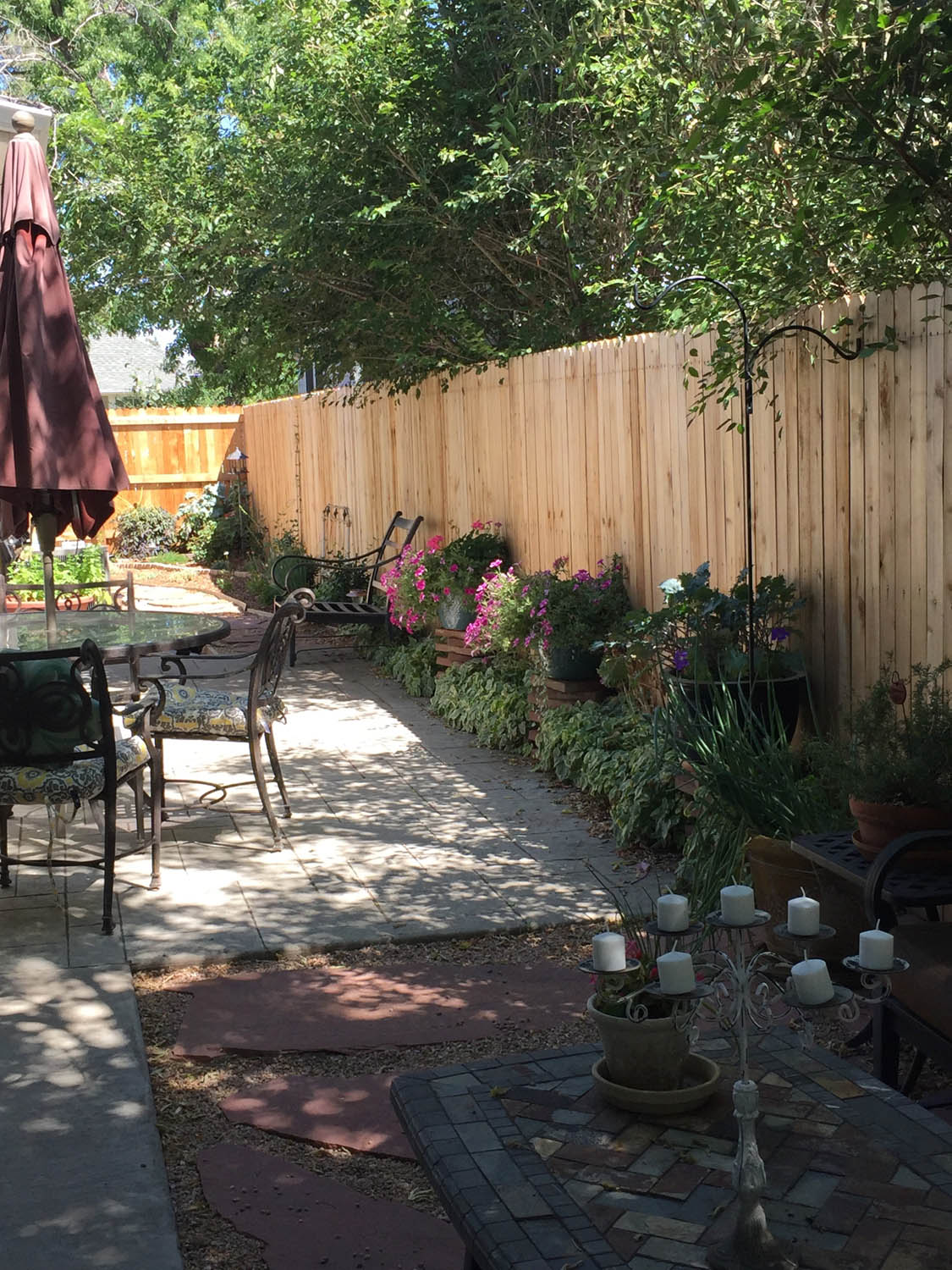 Patio after remodel with new fencing and flagstone pathways