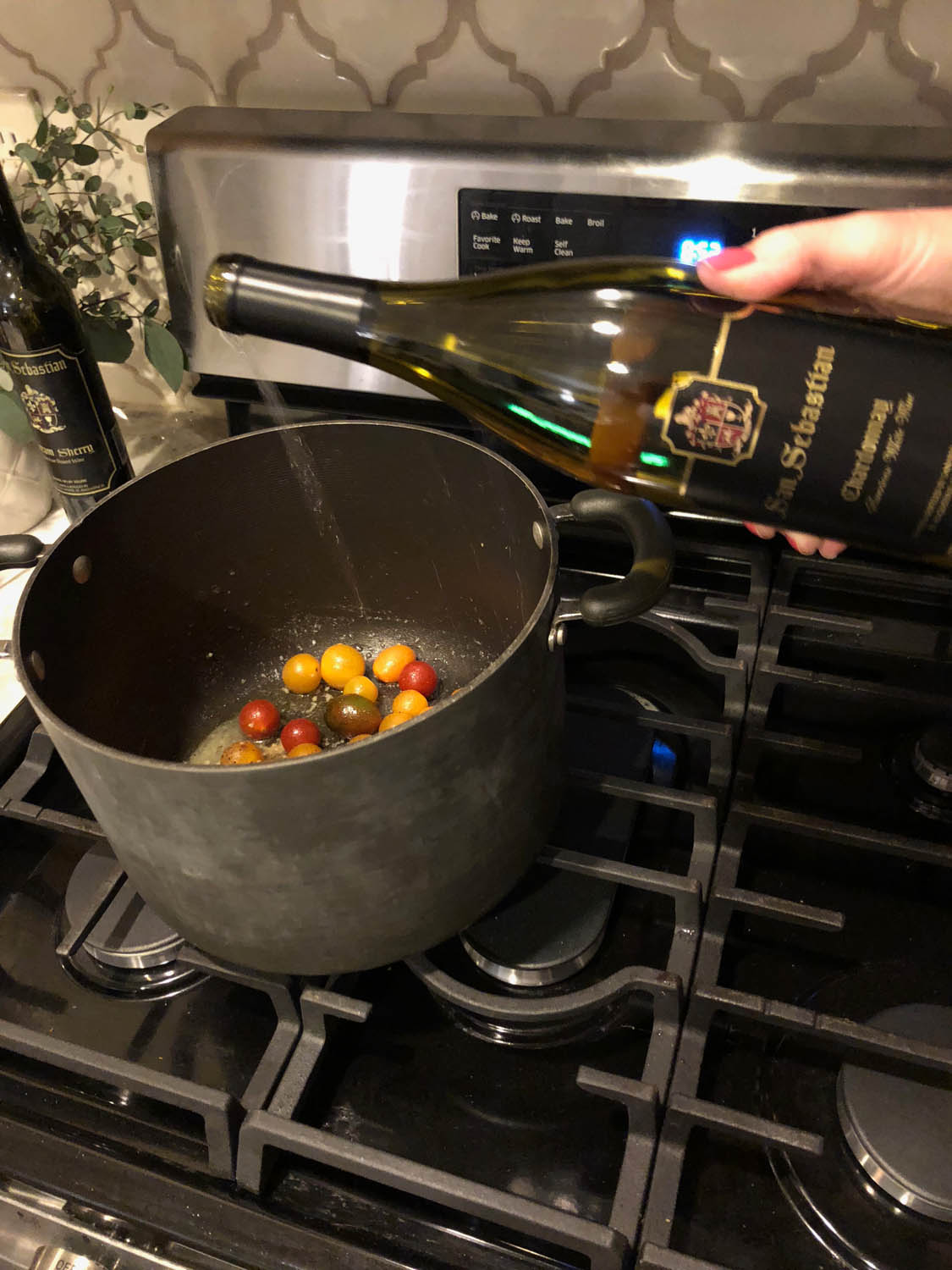 Adding wine to the pot of savory steamed mussels with tomatoes and white wine recipe.