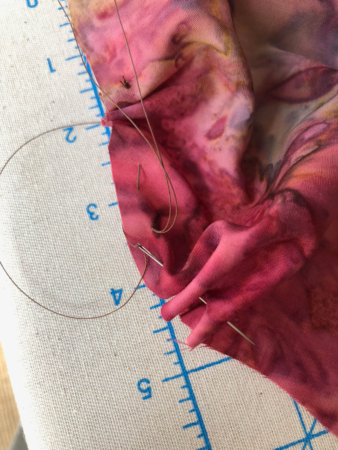 stitching around outer edge of batik fabric circle for pumpkin how to