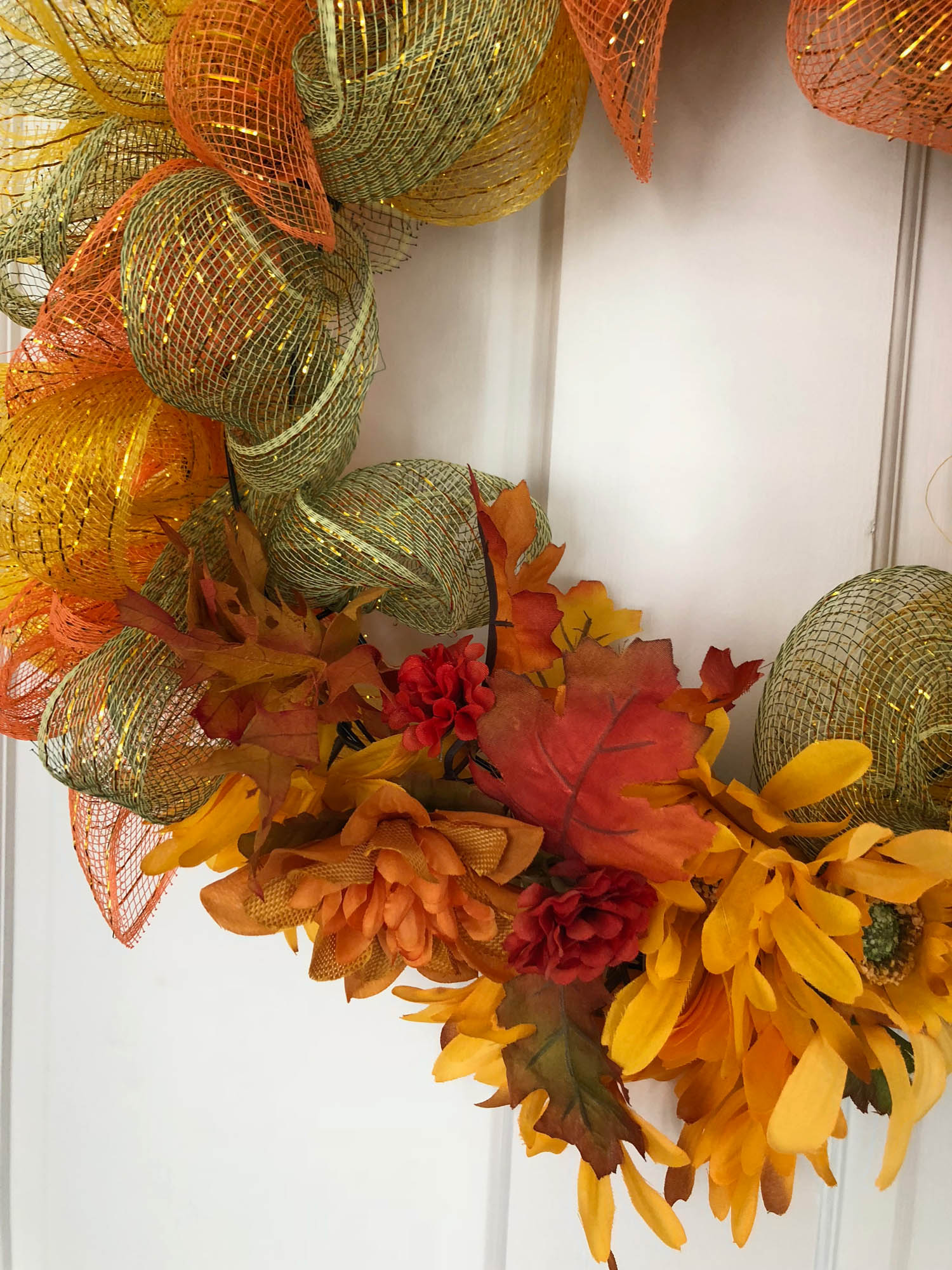 wired ribbon wrapped wreath for fall with floral embellishements