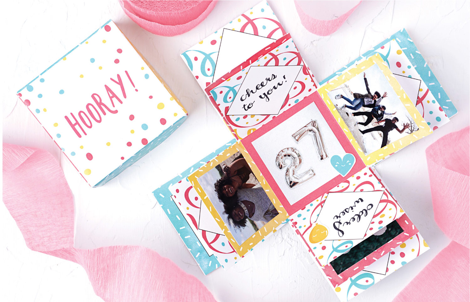 Assembled and embellished birthday explosion box free printable with pink confetti ribbon