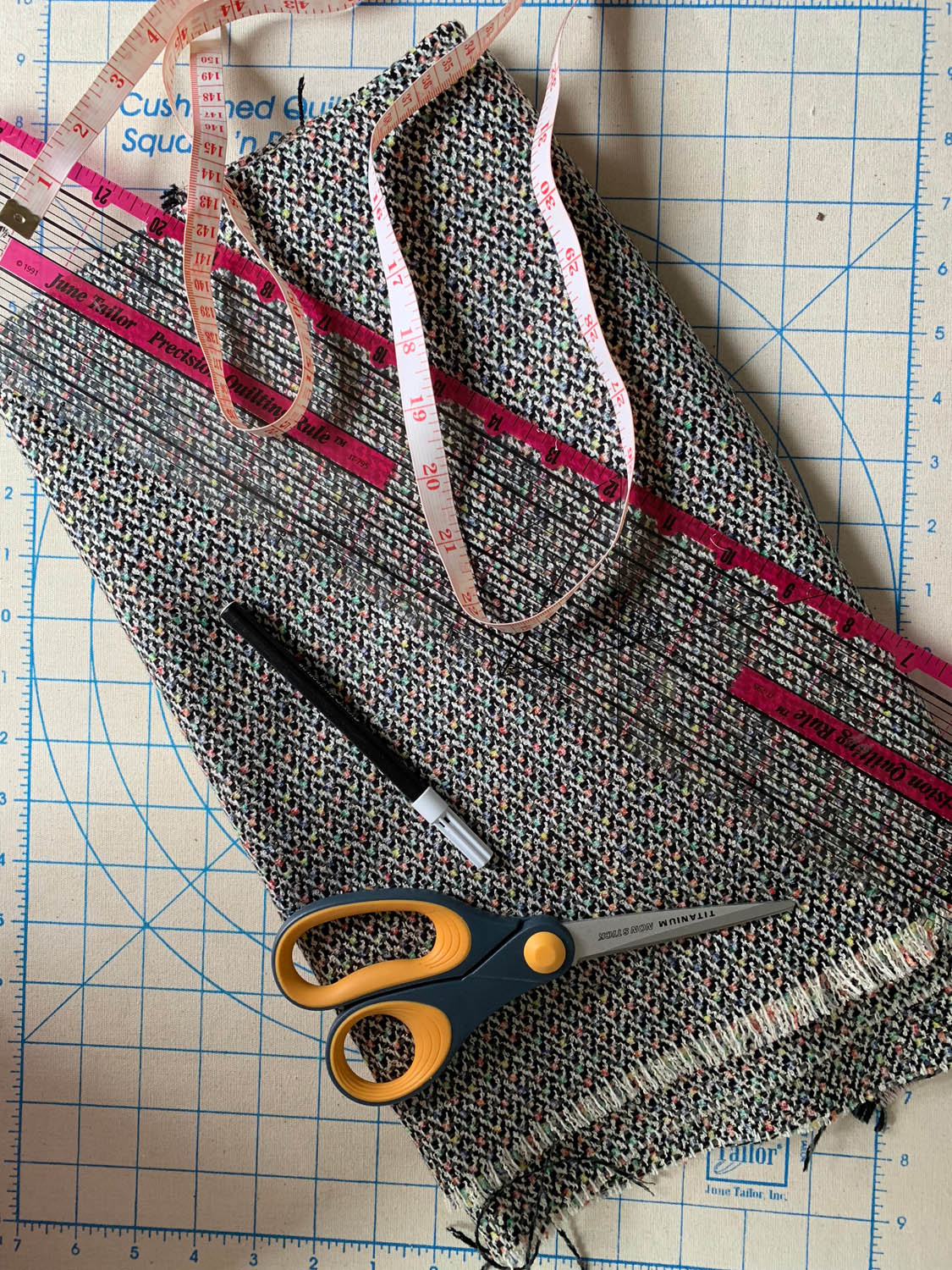 upholstery fabric yardage with scissors marking pen and ruler