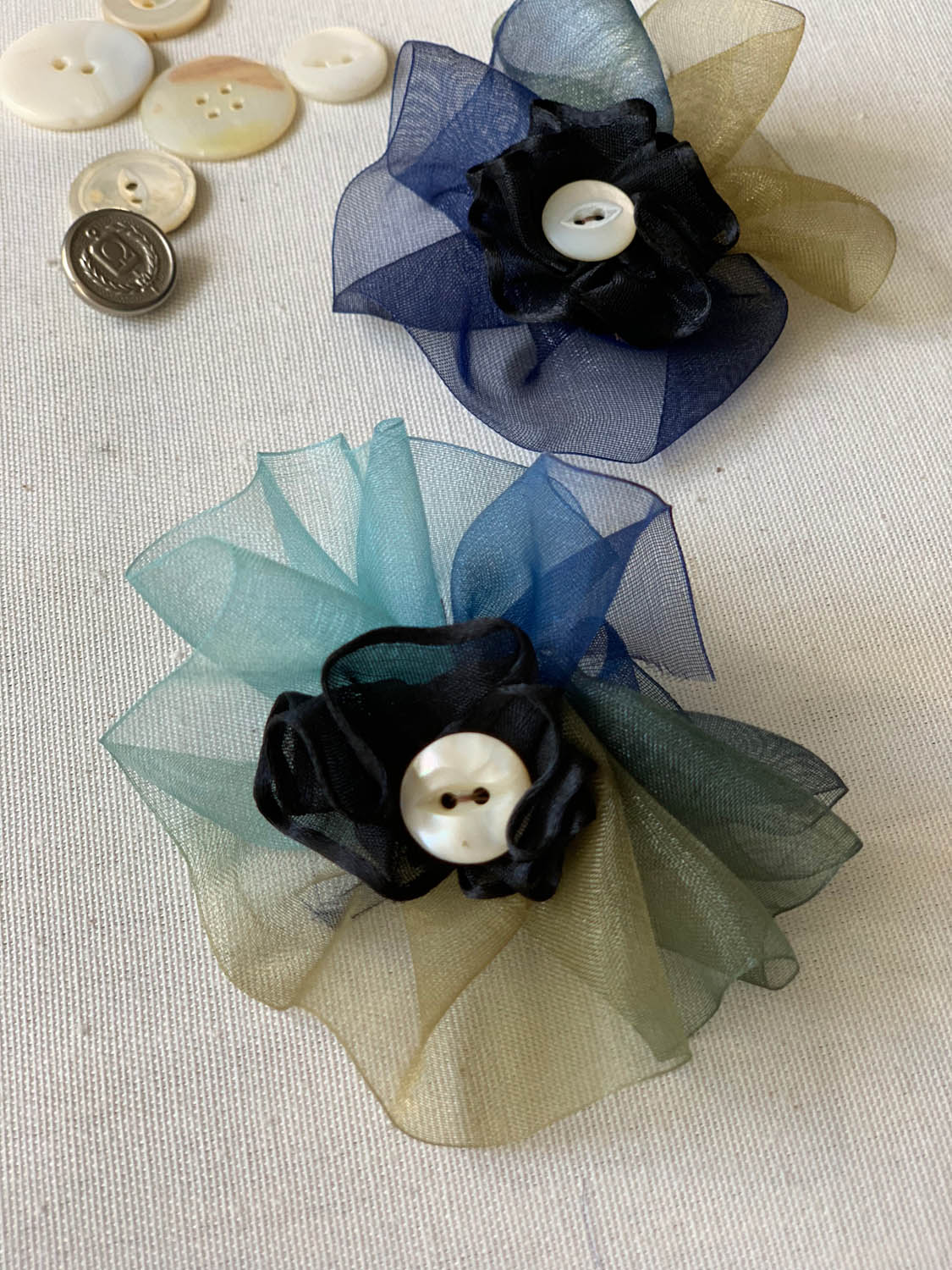 completed silk ribbon flowers with button embellishments