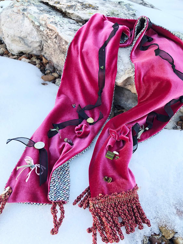 embellished elegant red velvet winter scarf on snow