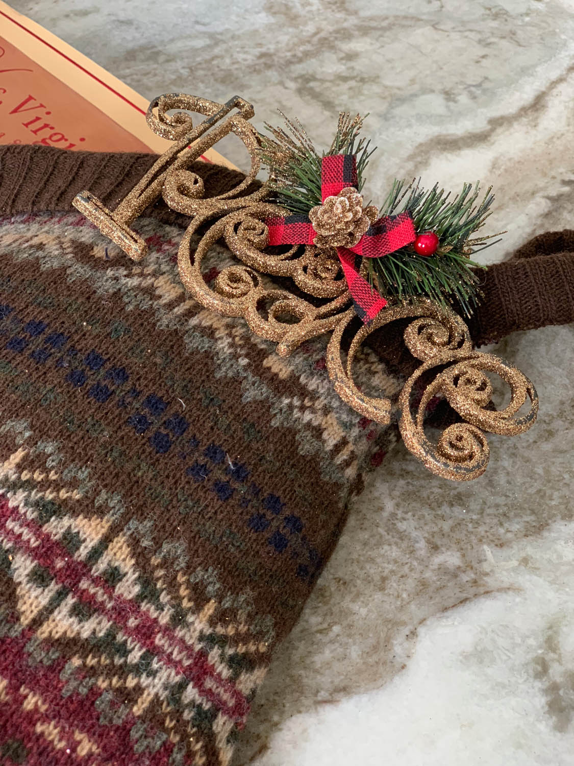 peace ornament on upcycled sweater Christmas stocking