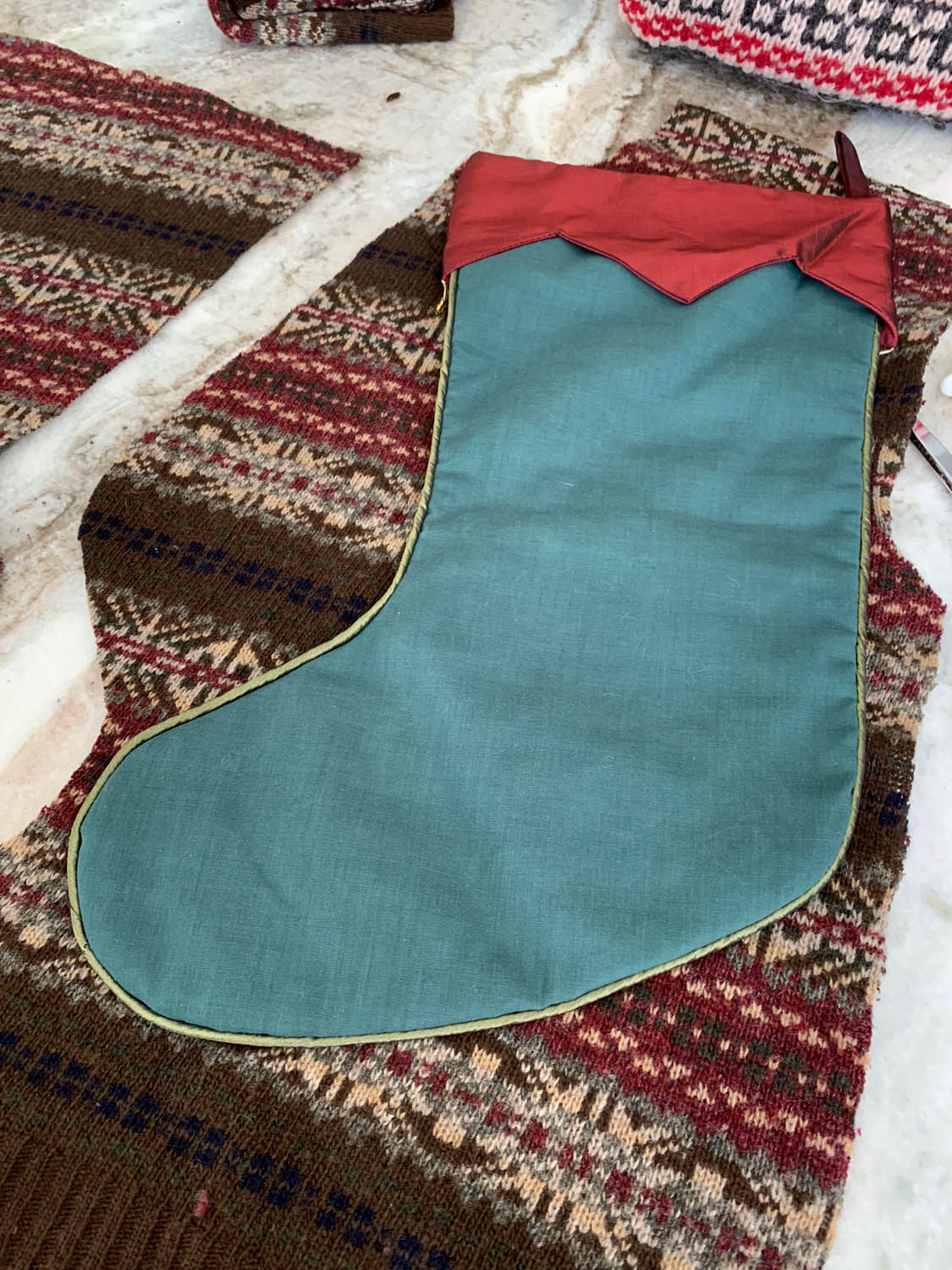 Wrong side of stocking pattern placed on right side of sweater to trace back of stocking
