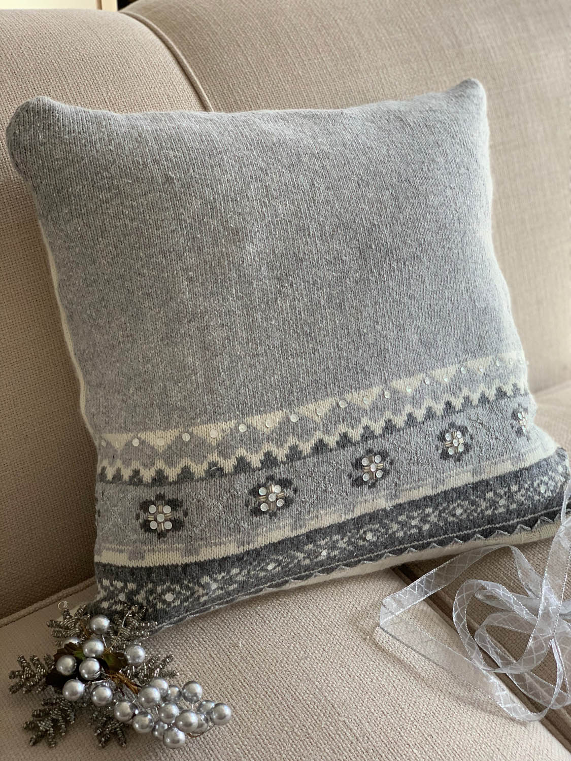 backside of holiday pillow from thrift store sweater gray white
