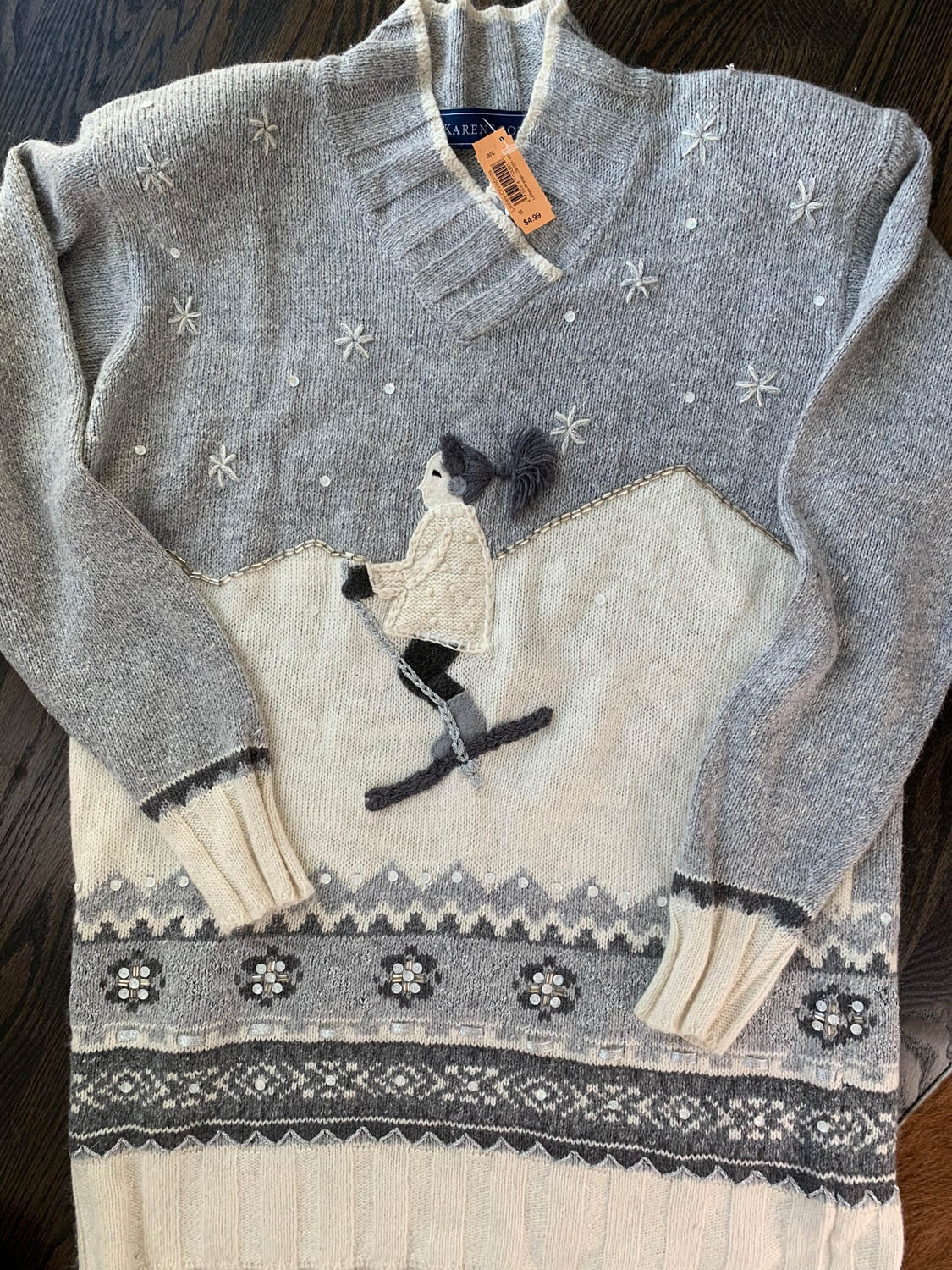 Holiday sweater found at thrift store to make an upcycled pillow; gray and white with girl skiing.