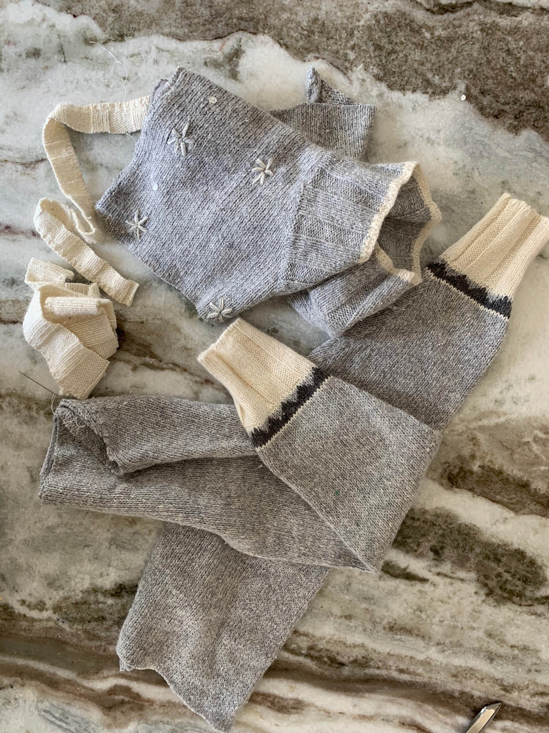 Leftover scraps from thrift store sweater after cutting out front and back for holiday pillow.