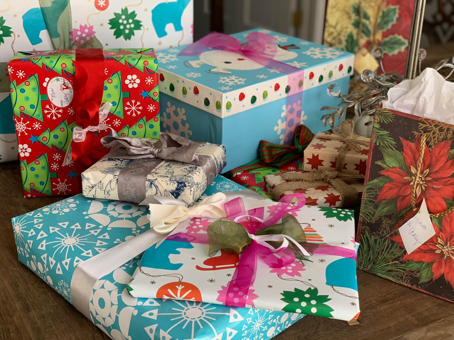 Stack of Christmas gifts with pretty creative wrapping techniques