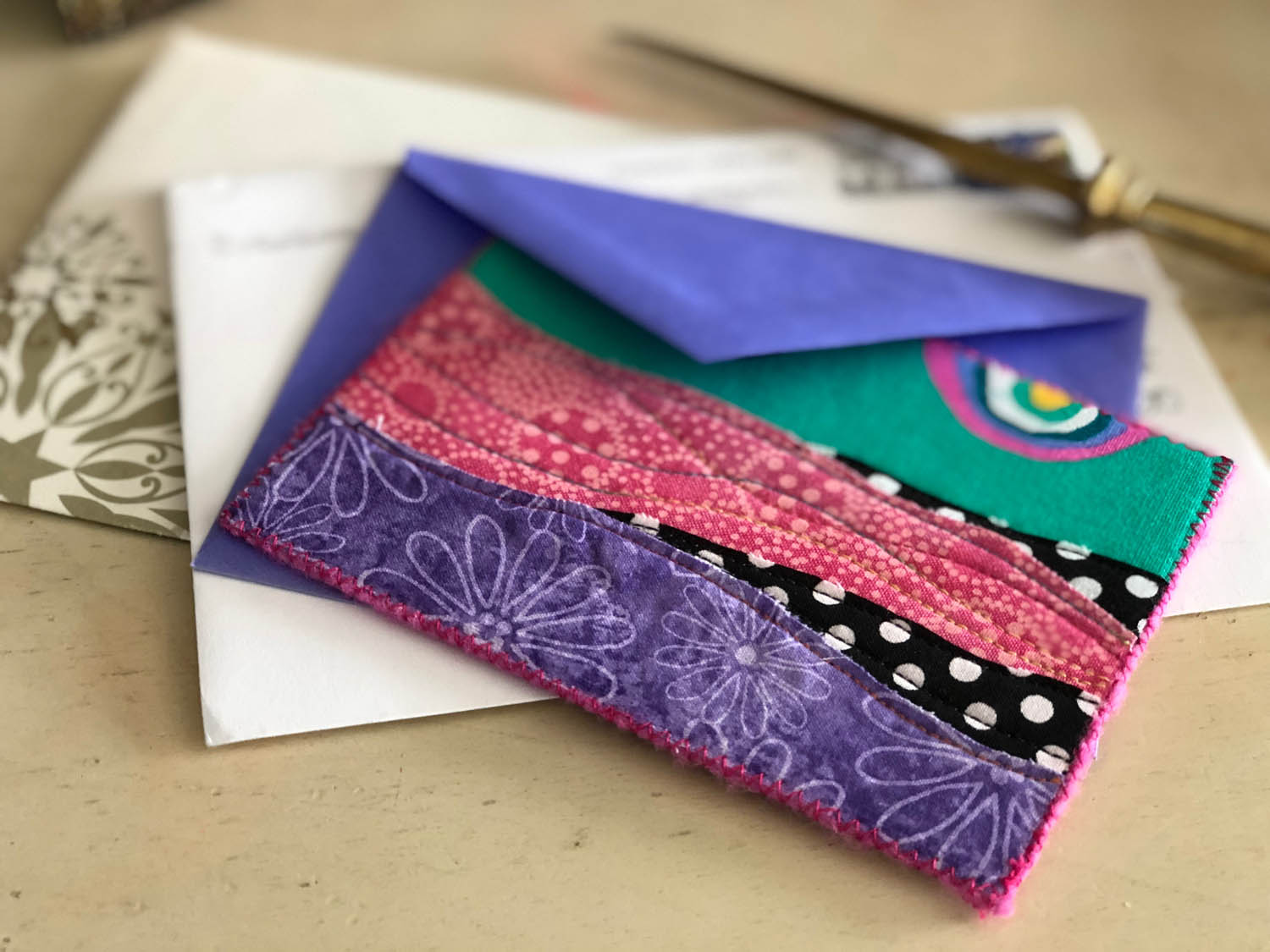 handmade gift card with fabric and stitching