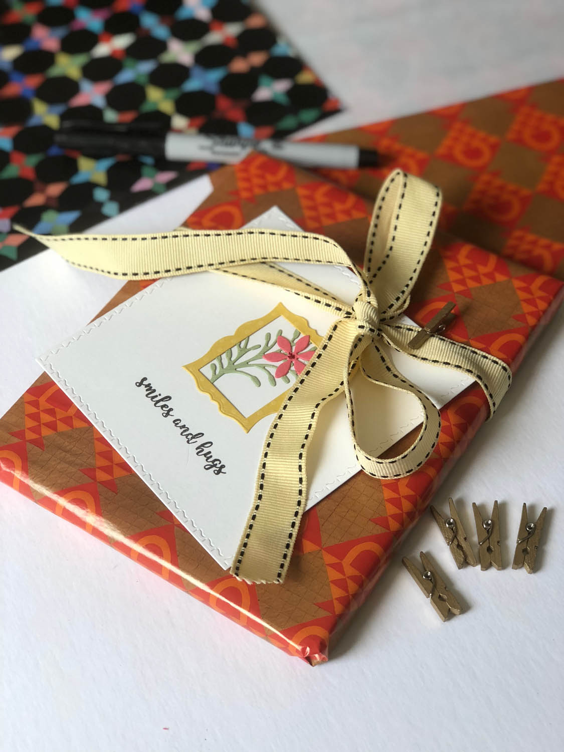 gift package for a quilter wrapped with a handmade card tied with a ribbon
