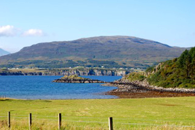 lake and mountain scenery along the route to Inveraray Scotland