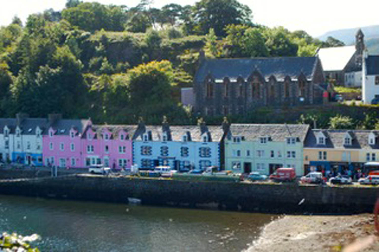 painted houses and businesses in northwest coastal village in Scotland