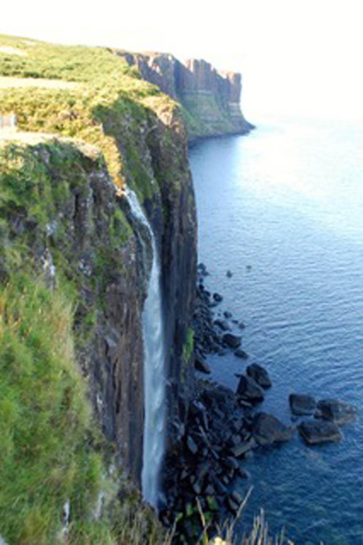 Waterfall over coastal cliff in eastern Scotland