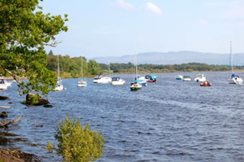 Lake with sailboats on eastern coast of Scotland