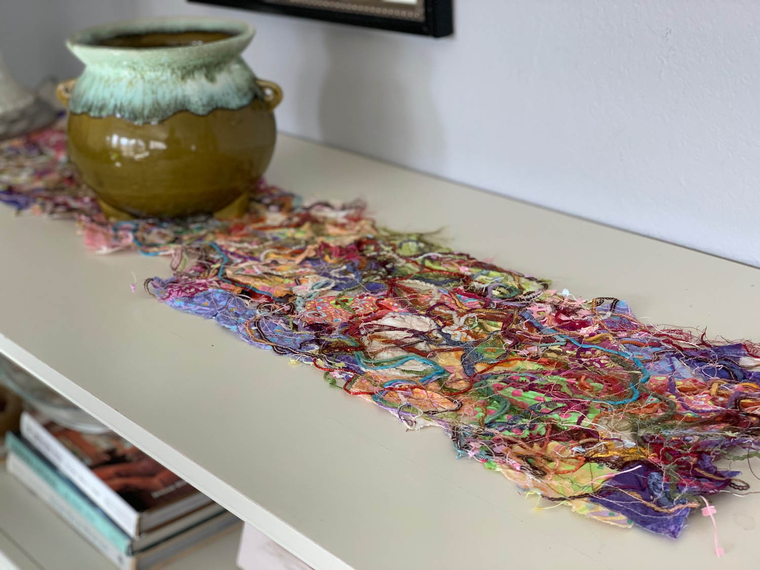 [Sulky Solvy] Upcycled Fiber Thread-Quilted table runner on counter with pottery