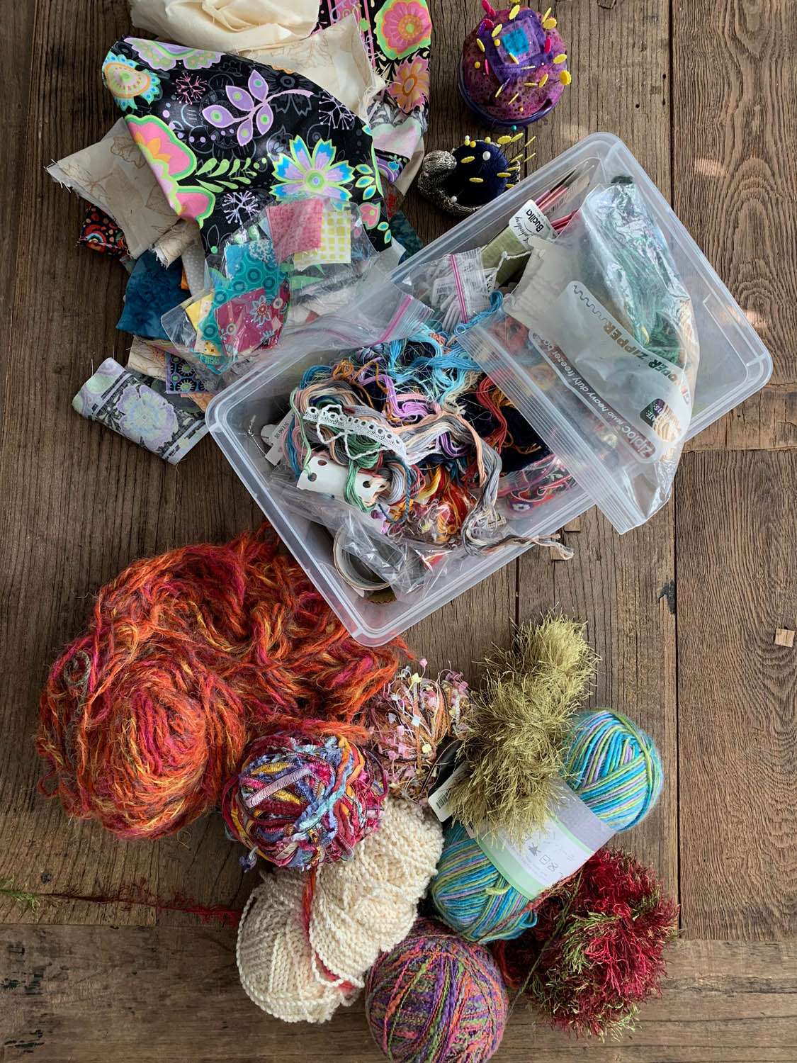 fabric lace and yarn fiber scraps from stash in bins
