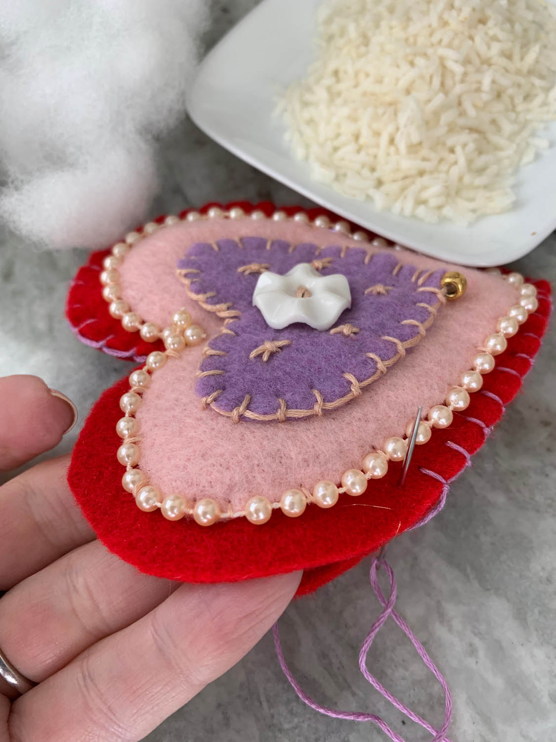 purple pink and red felt heart with opening for stuffing with fiberfill and rice