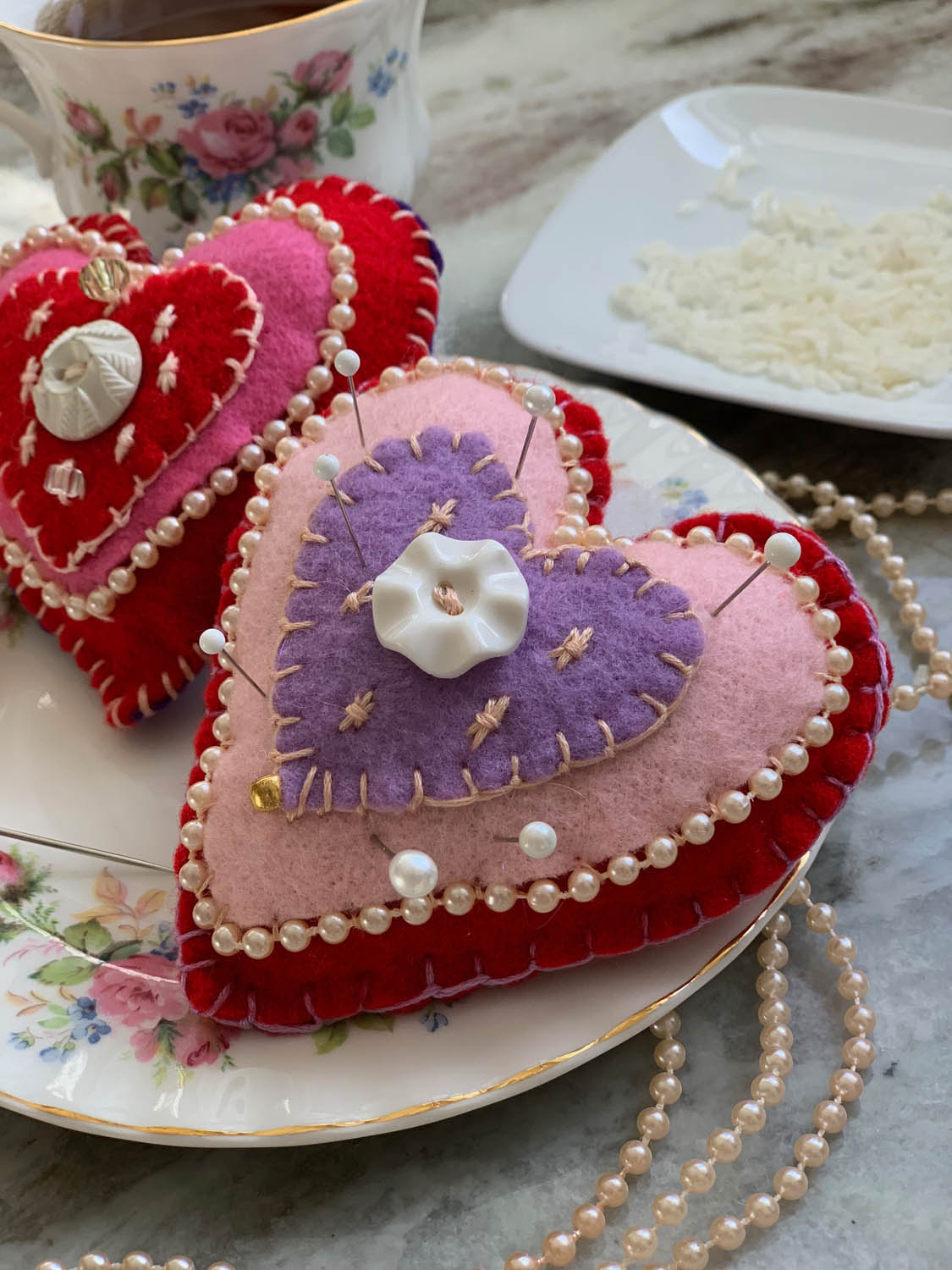valentine felt heart pincushions stuffed with fiberfill and rice for weight