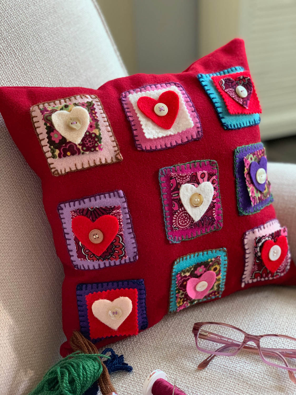 finished folksy felted Valentine's Day heart nine-patch pillow with hand embroidery and buttons