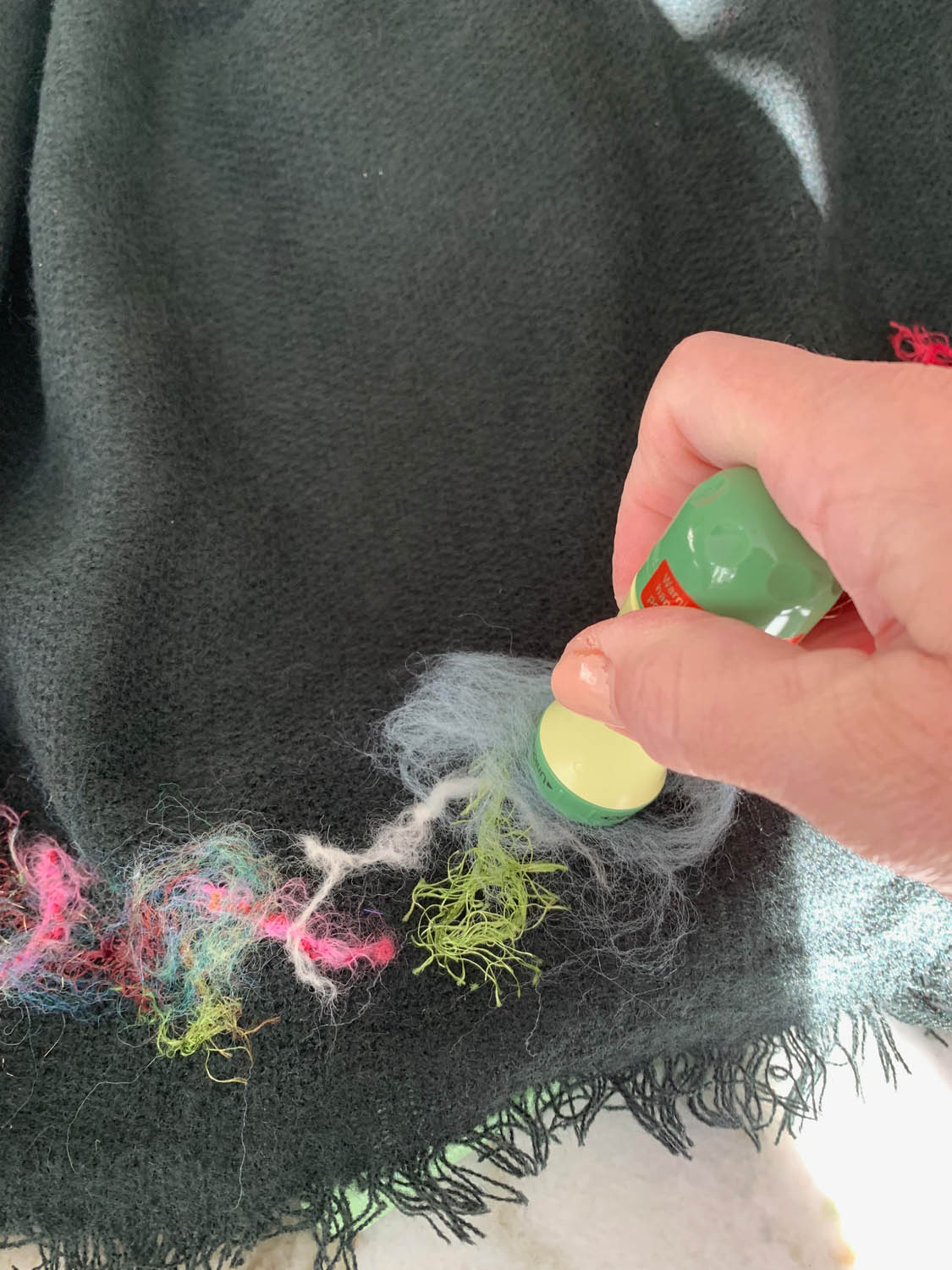 fibers being felted into a pre-made shawl border