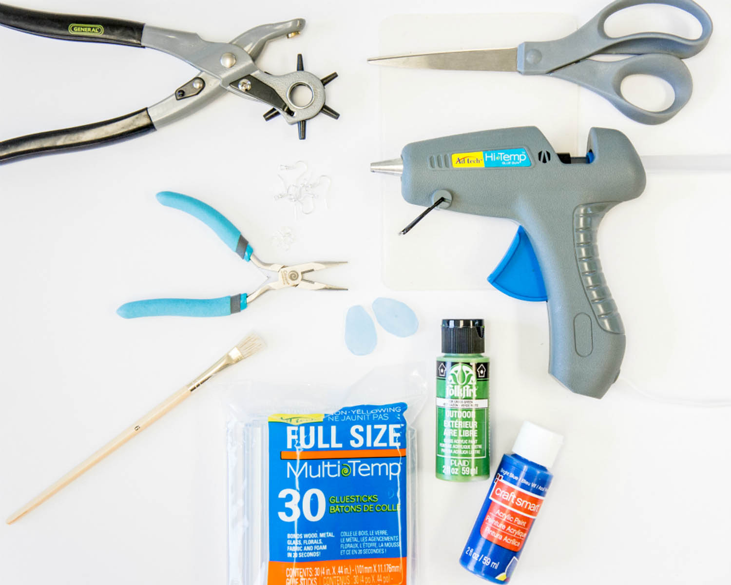 hot glue gun, hot glue sticks, acrylic paint, pliers, jewelry findings to make DIY sea glass earrings from hot glue