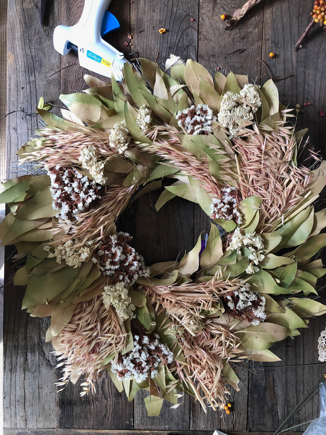 Faded old wreath ready for upcycle redo.