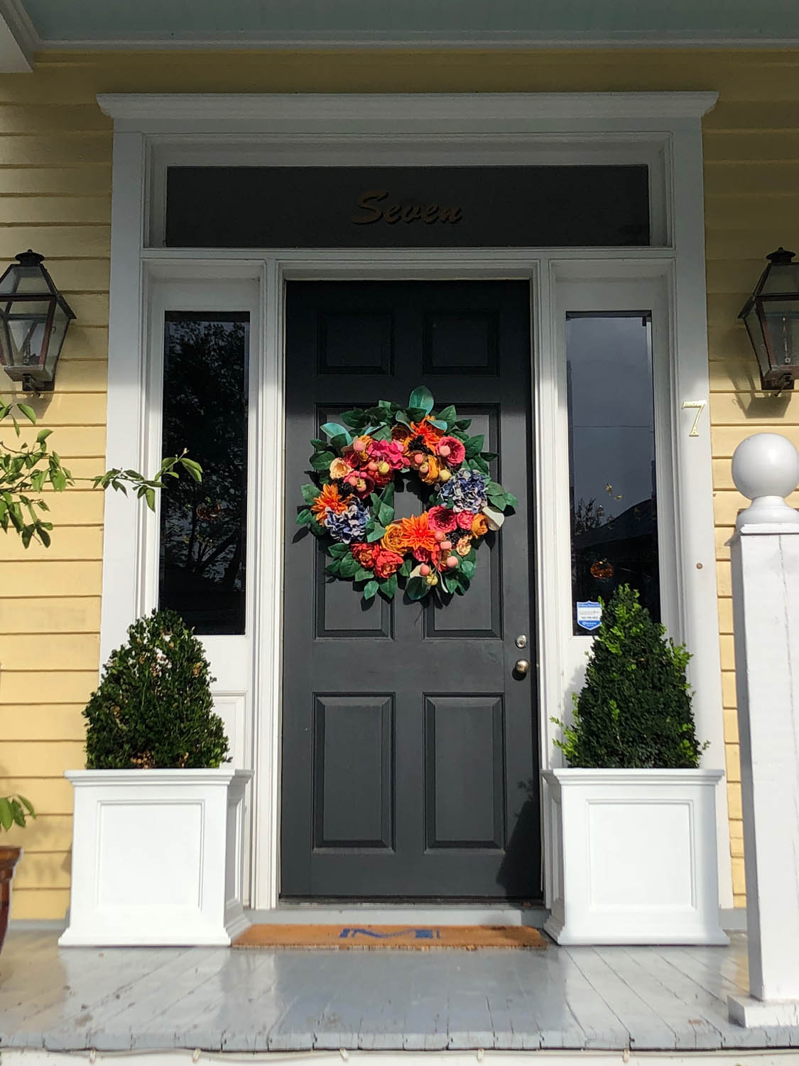 Charleston door with floral wreath and yellow exterior