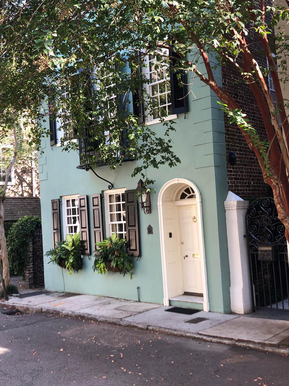 narrow Charleston home painted green