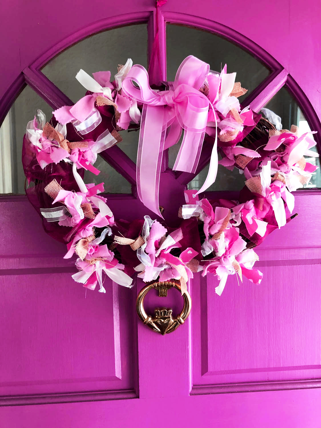 pink front door with heart-shaped valentine wreath