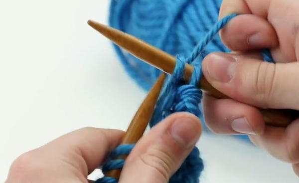knitting needles with two knit stitches on one needle