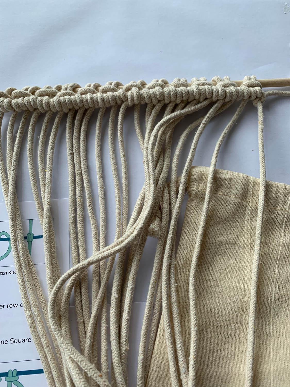 macrame strings on a dowel