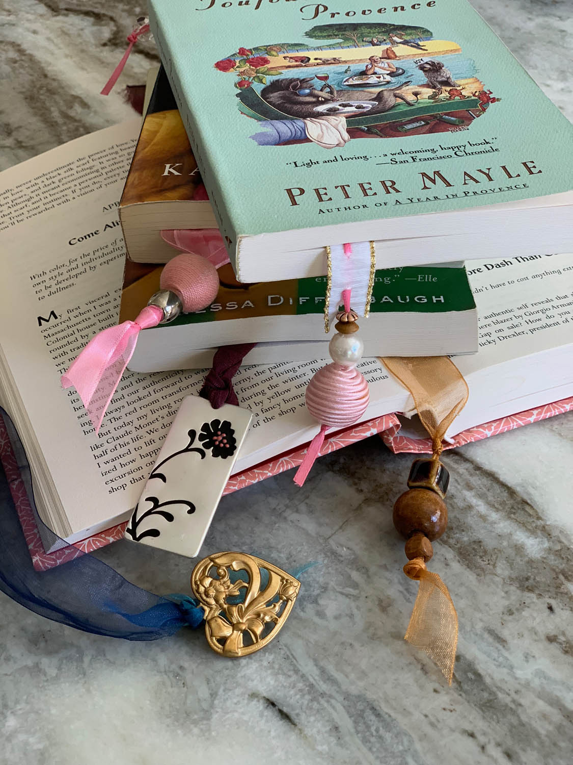 Finished ribbon bookmarks with charms in assorted books.