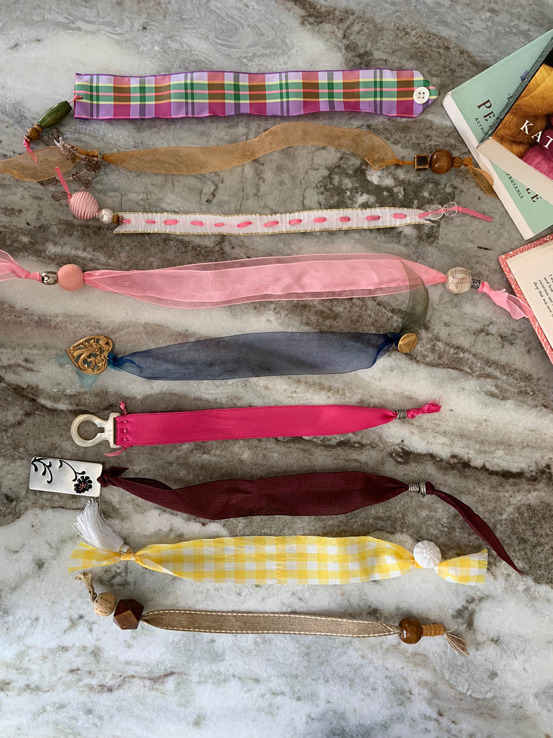 group of finished easy DIY ribbon bookmarks with bead trims