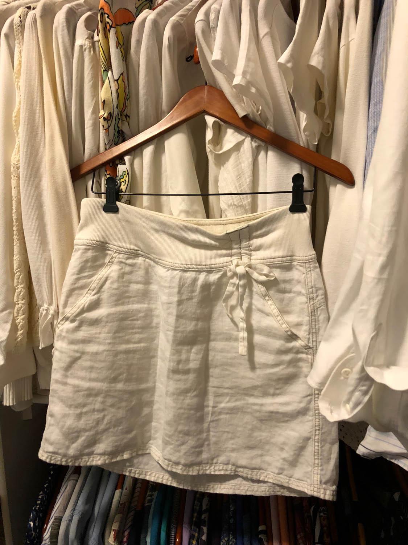 white linen skirt hanging in closet