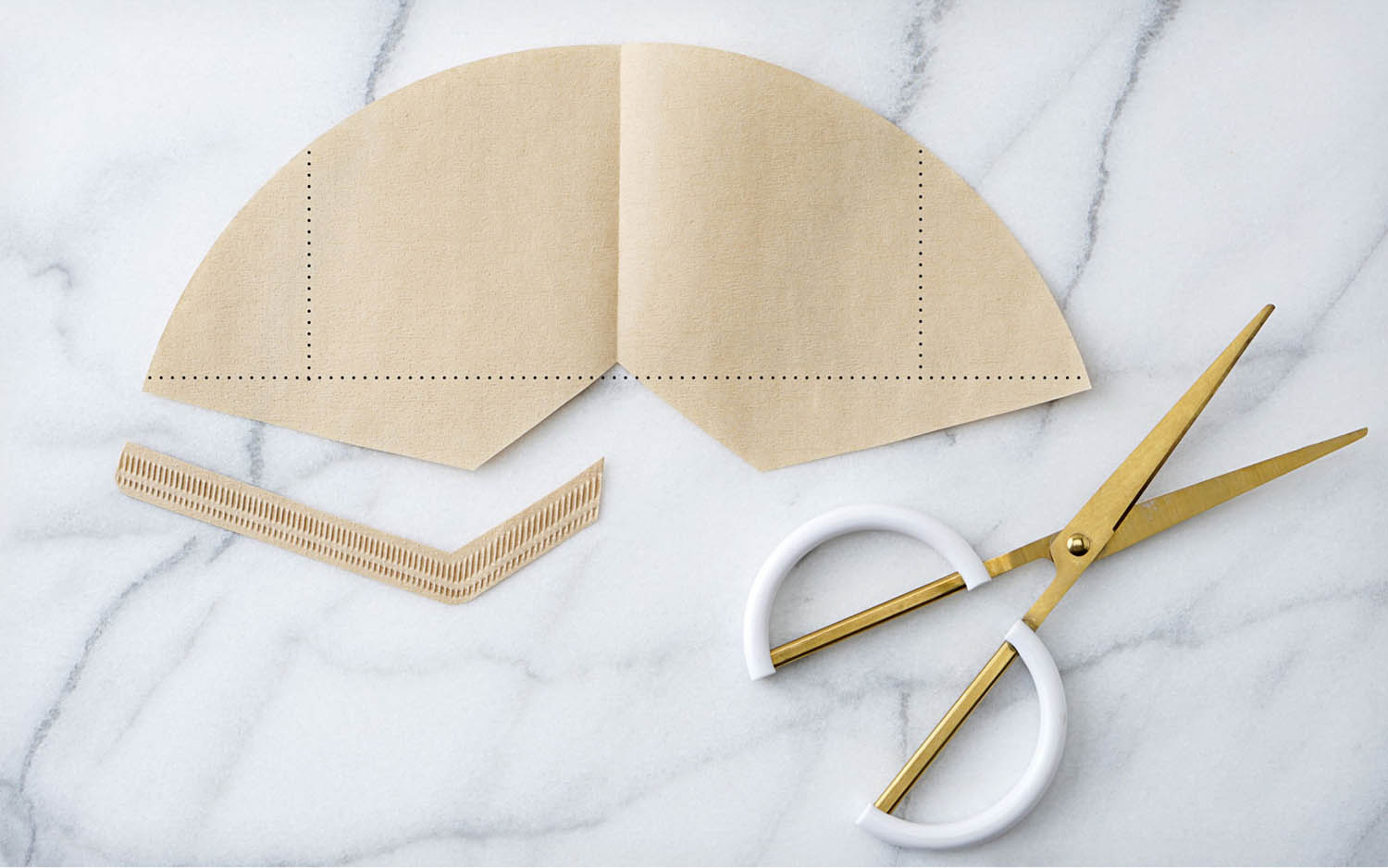 Cone shaped coffee filter cut to lay flat
