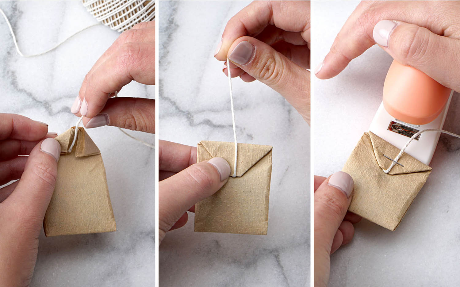 Folding the string into the top folded tea bag paper filter prior to stapling the string that will hold the printable tea bag tag