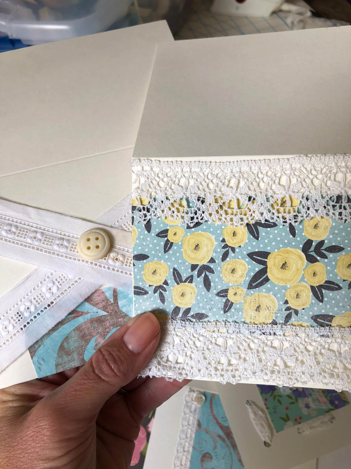Hand embellished cards with scrapbook paper and lace sewn on for trim