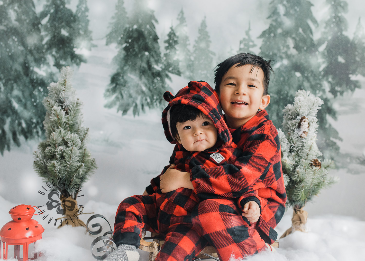 two brothers wearing red and black pijama