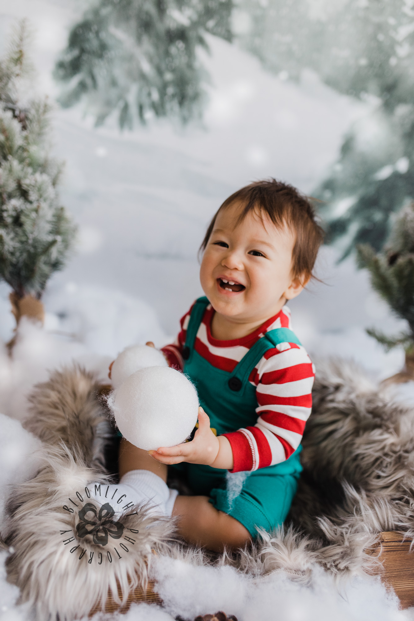 Happy baby holding snowballs, Toronto