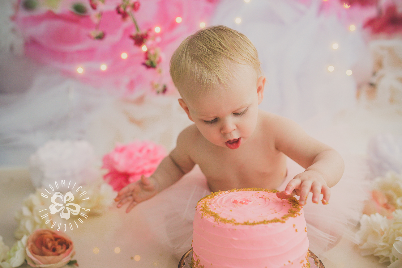 Toronto baby girl eating her first birthday smash cake (3).jpg