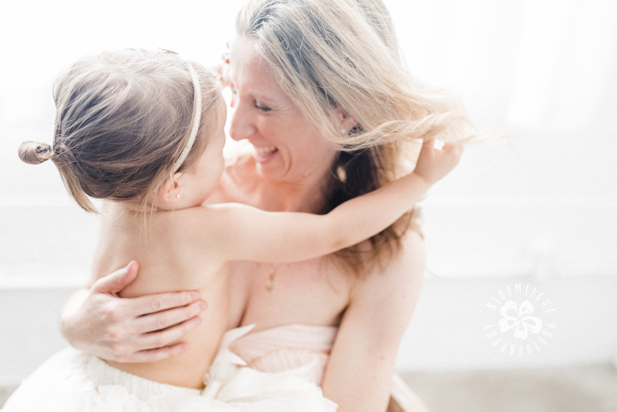 Fine Art photo of mommy and daughter in a bright studio in Toronto having fun together