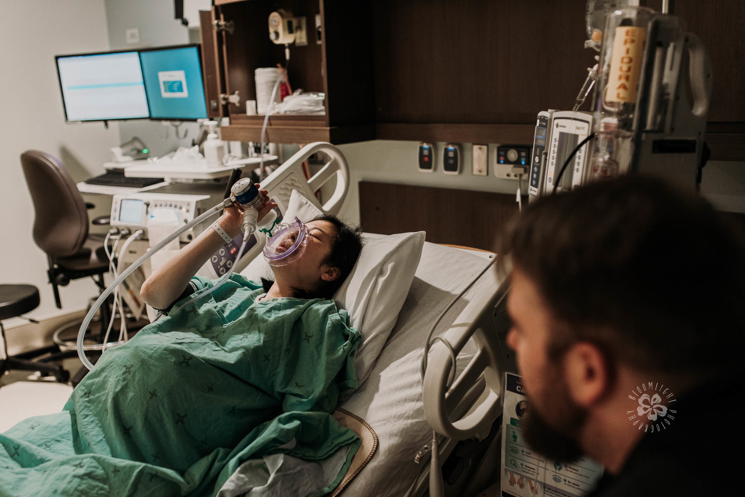 pregnant mom using gas to decrease labor pain in hospital